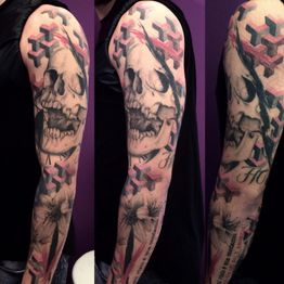 Full sleeve tattoo by Camilla Falco